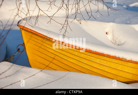Boat filled with snow at Winter  , Finland - Stock Image