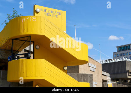Southbank Centre yellow spiral staircase connecting different floors of the cultural complex. - Stock Image