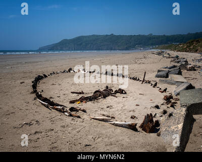 Sunken boat in Pendine sands, Carmarthen Bayon the south coast ofWales, UK - Stock Image
