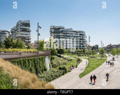 Residential upmarket apartment buildings and gardens in the Citylife District of Milan, Lombardy, Italy - Stock Image