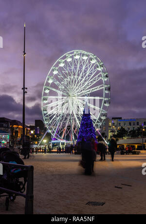 The Big Wheel illuminated at Christmas in Bournemouth at Pier Approach in the evening, Bournemouth, Dorset, England, UK - Stock Image