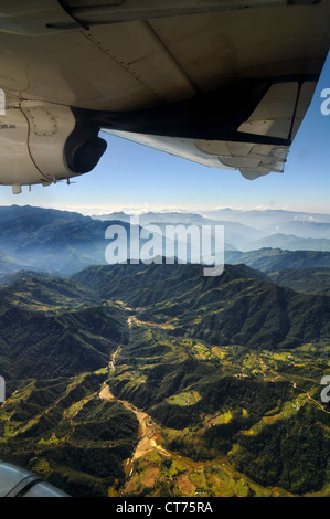 view from airplane at mountain range in Nepal - Stock Image