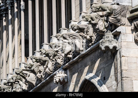 Exterior detail of carvings on the Cathedral of Saint Benignus of Dijon, Dijon, France - Stock Image