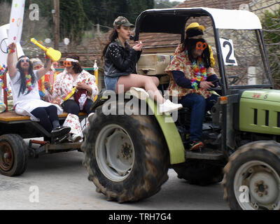 Hippy float from Nymfes carnival making it's way through Xanthates to Roda, Corfu, Greece - Stock Image