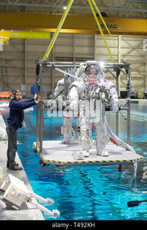 Commercial Crew Program astronaut Mike Fincke, in his spacesuit is lowered into the pool at the Neutral Buoyancy Laboratory for ISS EVA training in preparation for future spacewalks while onboard the International Space Station at the Johnson Space Center February 1, 2019 in Houston, Texas. - Stock Image