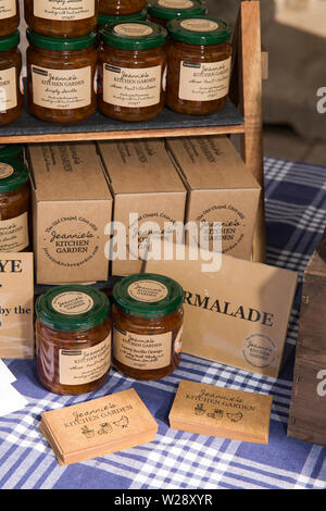 UK, Cumbria, Sedbergh, Main Street, monthly artizan's market, Jeannies Kitchen Garden locally made jams and preserves displayed on roadside food stall - Stock Image