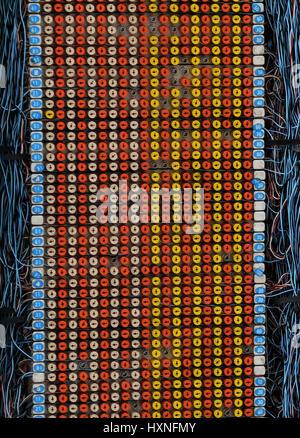 Telecom engineer working on a telephone wiring junction box Danshui Taiwan - Stock Image