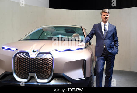 Munich, Germany. 20th Mar, 2019. Harald Krüger, Chairman of the Board of Management of BMW AG, stands in front of the Vision iNext concept car at the annual press conference of the automobile manufacturer BMW. Although BMW sold more cars last year, it still made significantly less profit than in the previous year. Photo: Tobias Hase/dpa Credit: dpa picture alliance/Alamy Live News - Stock Image