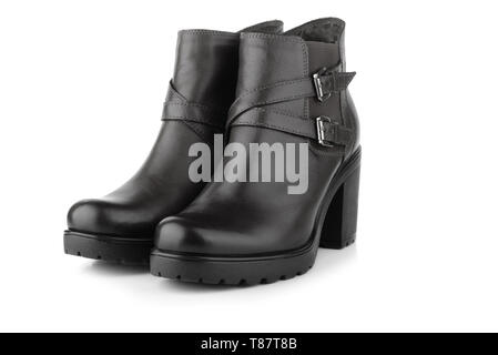 Pair of black leather woman winter boot isolated on white - Stock Image