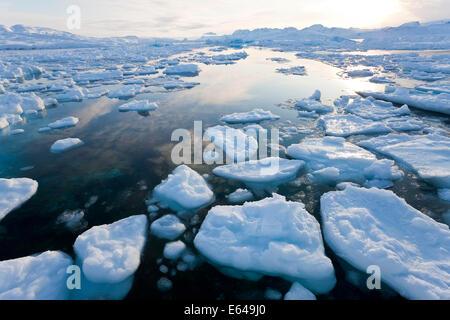 Tiniteqilaq and sea ice in fjord, E. Greenland - Stock Image
