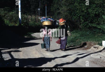 Indigenous Kiche Mayan women walk home after attending the market in Momostenango Township, Guatemala. - Stock Image
