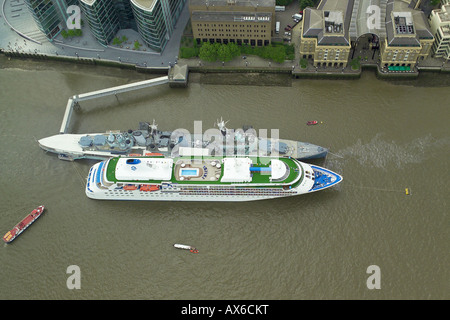 Aerial view of the cruise ship Silver Cloud moored by HMS Belfast on the River Thames at Southwark in London - Stock Image
