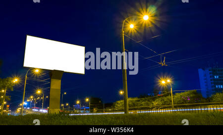 Mockup white empty screen billboard on highway with traffic - Stock Image