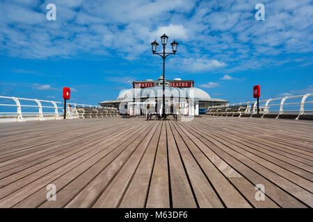 View along Cromer pier to the Pavilion theatre. - Stock Image