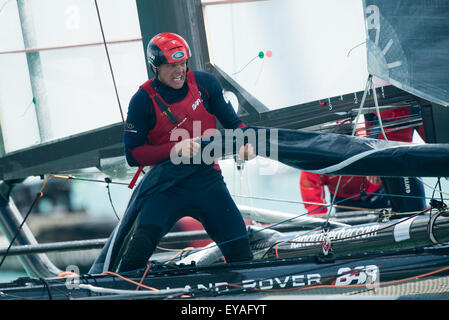 Portsmouth, UK. 25th July 2015. Landcover BAR crewman rolls the sail after Ben Ainslie steers them to victory in - Stock Image