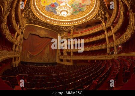 Paris, France - October, 2017: Auditorium inside of the Palais Garnier Opera Garnier in Paris, France. The seven-ton bronze and crystal chandelier was designed by Garnier. - Stock Image