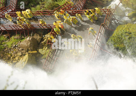Niagara Falls, USA – August 29, 2018: A wooden walkway takes visitors to the base of the American falls in Niagara Falls, New York State, USA - Stock Image