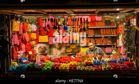 Christmas market stall in Gent after sunset - Stock Image