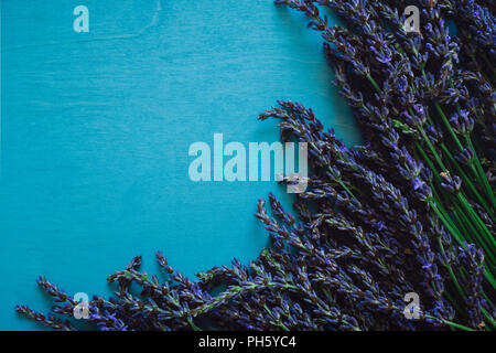Lavender on Turquoise Table with Space for Copy - Stock Image
