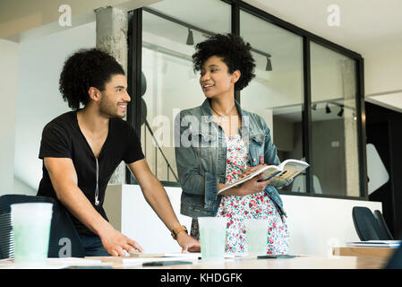 Colleagues working together in office - Stock Image