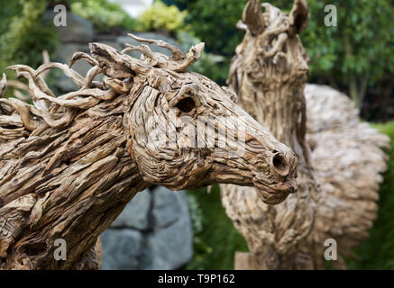 London,UK,20th May 2019,Horse statues made from driftwood at the RHS Chelsea Flower Show Press Day which takes place before it officially opens tomorrow until Saturday 25th May. The world renowned flower show is a glamourous, fun and an educational day out which is attended by many celebrities. There are many gardens, floral displays, Marquees all set in the glorious grounds of The Royal Hospital Chelsea.Credit: Keith Larby/Alamy Live News - Stock Image