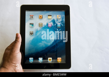 Man holding Apple iPad, TouchscreenTablet Computer, Book Reader, Digital Ebook, Modern, Brand, Luxury, screensaver, - Stock Image