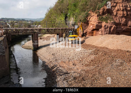 Work begins at the mouth of the river Sid, at Sidmouth, for the repkacement of the Alma Bridge, which is being moved about 100 yards further inland. - Stock Image