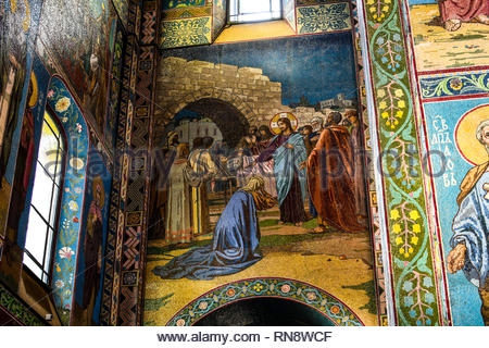 Close up detail inside the Church of the Savior on Spilled Blood in St Petersburg, Russia, depicting religious scene in mosaics - Stock Image