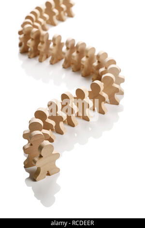 A line of small wooden people - Stock Image