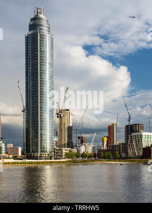 London, England, UK - May 28, 2019: The St George's Wharf skyscraper and other new build apartment buildings stand among construction cranes in the Ni - Stock Image