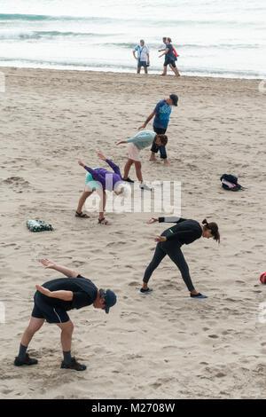 Seniors keeping fit on the beach in Benidorm, Spain. Men women oap's, elderly fitness class - Stock Image