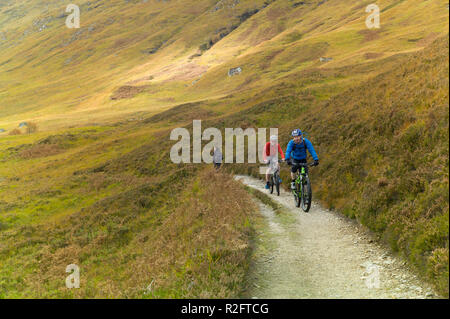 Cyclists  on the north side footpath beside  Loch Affric Glen Affric, Highlands, Scotland. - Stock Image