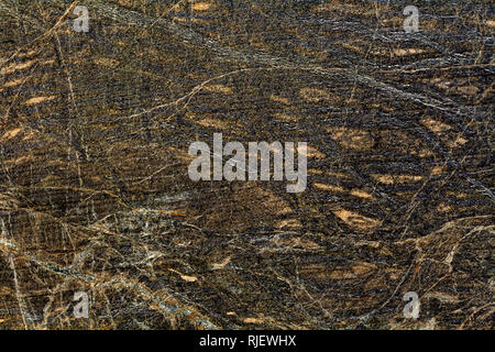 Serpentinite is a rock composed of one or more serpentine group minerals, the  texture of the rock resembles the skin of a snake- geology texture and  - Stock Image