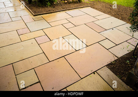 New paving slabs in position awaiting grouting - Stock Image