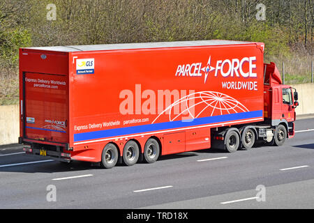 Side view of UK Royal Mail hgv lorry truck & red Parcel Force juggernaut trailer advertising worldwide express parcels delivery on motorway England GB - Stock Image
