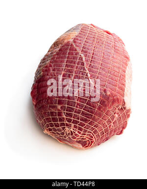 Raw beef  meat in a net isolated on white - Stock Image
