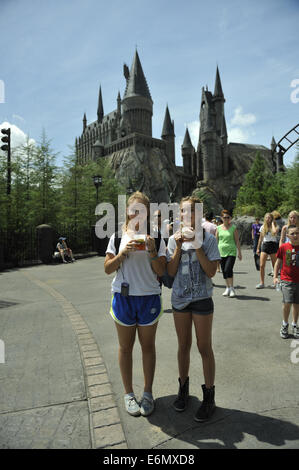 Two young Australian sisters enjoying a drink at Harry Potter World, Universal Orlando Resort, Orlando, Florida, - Stock Image