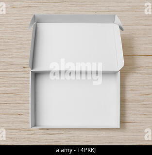 White cardboard box top view on white wood background or floor - Stock Image