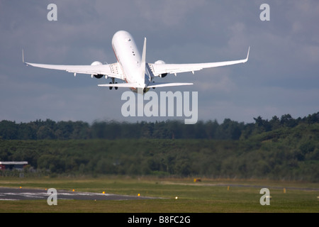 Business jet taking off - Stock Image