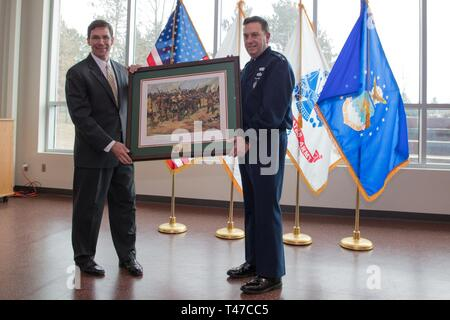 HANSCOM AIR FORCE BASE, Mass. – Dr. Mark T. Esper, Secretary of the Army, joins Maj. Gen. Gary W. Keefe, the Adjutant General of the Massachusetts National Guard and other senior leadership during a visit to Joint Force Headquarters of the Massachusetts National Guard, here, March 15, 2019. After an awards ceremony held to recognize soldiers and civilians of the Massachusetts Army National Guard, Esper held a town hall to communicate and connect with the soldiers and airmen of the Commonwealth. - Stock Image