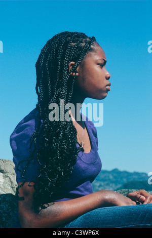 African American teenage girl in profile outside - Stock Image