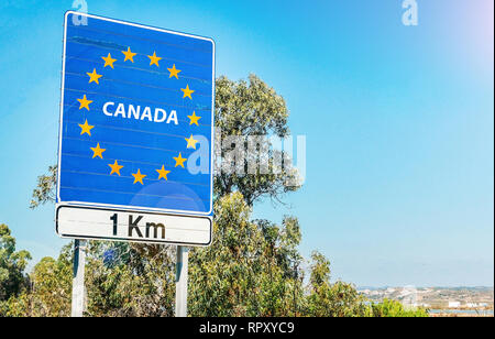 Spoof road sign on the border as part of an European Union member state, Canada which is a significant trading partner EU - Stock Image