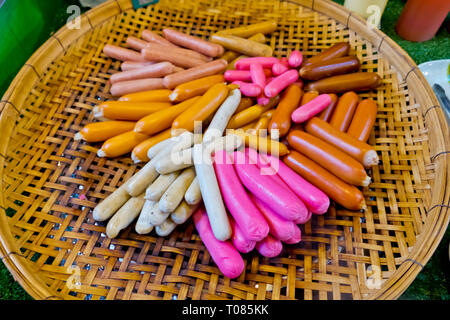 Sausages of different colours, Star Night Bazaar, night market, Rayong, Thailand - Stock Image