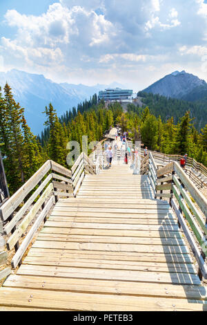 BANFF, CANADA - AUG 1, 2018: Visitors walk the wooden boardwalk on top of Sulphur Mountain between the Gondola summit and Sanson's Peak for a panorami - Stock Image