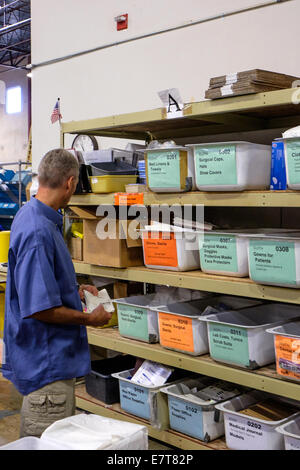 Centennial, Colorado USA. 23 September 2014.  Robert Hartman from the U.S. Tax Department of Suncor Energy searches - Stock Image