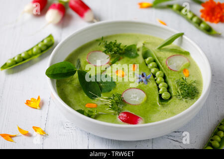 Summer pea soup with fresh vegetables - Stock Image