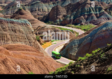 A winding road through the colorful mountains in Zhangye National Geopark, Zhangye, Gansu Province, China - Stock Image