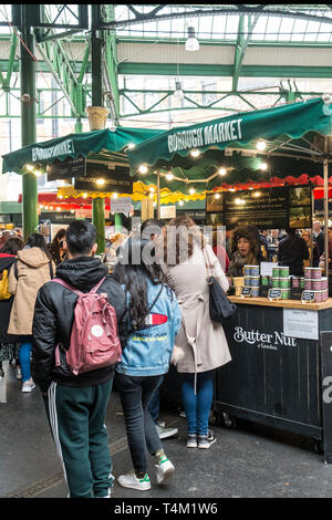 Food Stalls in Borough Market in London. - Stock Image