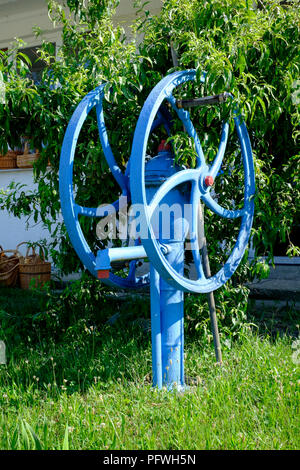 large restored water pump in the rural village of csesztreg zala county hungary - Stock Image