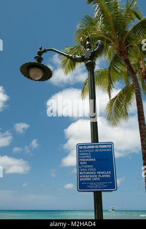 Sign with list of prohibitied activities, including 'horseshoe playing'. Waikiki, Honolulu, Hawaii, USA - Stock Image